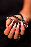 Nails and pearls Stock Photo