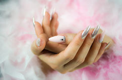 Nails pink and pearl with diamonds Royalty Free Stock Photo