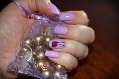 Nails purple colors into the design Stock Image