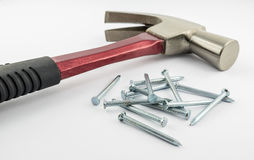 Nails with red iron hammer Royalty Free Stock Images