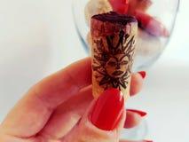 Nails rednails woman cork wineglass glass sun face. Sun face symbol nails cork Stock Photography
