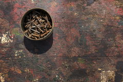 Nails in rusty tin can on a wooden background. Nails in a rusty tin can on a wooden background Stock Image