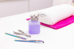 Nails saloon nail polish remover with manicure tools on white Stock Photos
