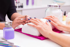 Nails saloon woman nail polish remove with tissue Royalty Free Stock Photos
