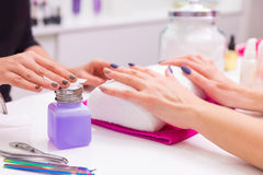 Nails saloon woman nail polish remove with tissue Stock Image