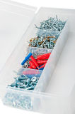 Nails and screws in box. On white background Stock Image