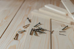 Nails, screws lie on the floor Royalty Free Stock Images