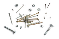 Nails, screws, nuts and bolts. Set of different nails, screws, nuts, bolts,  on white background Royalty Free Stock Image