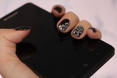 Nails in tone smartphone Royalty Free Stock Photo