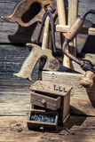 Nails and Tool box carpenter. On old wooden table stock photography