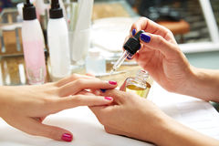 Nails top coat finishing vernis after nail polish Stock Images