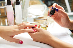 Nails top coat finishing vernis after nail polish Royalty Free Stock Images