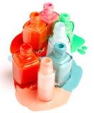 Nails varnish bottles on white background. Rose, red, blue. green, orange, white Stock Images
