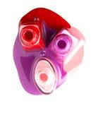 Nails varnish bottles on white background. Rose, red, violet Royalty Free Stock Images