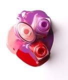 Nails varnish bottles on white background. Rose, red, violet Stock Photo