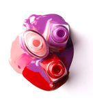 Nails varnish bottles on white background. Rose, red, violet Royalty Free Stock Photos