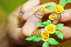 French manicure. Nails on a woman's hands with the help of coloured thread and acrylic roses stock photos