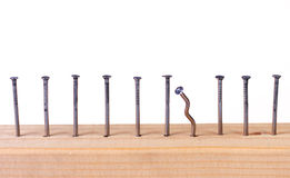 Nails in wooden plank. Row of nails in wooden plank stock photos