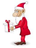 Nain de Noël avec le cadeau Images libres de droits