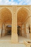 Nain old mosque architecture. NAIN, IRAN - MAY 6, 2015: Arcade in inner courtyard of the old Jame mosque in Iran Royalty Free Stock Photos
