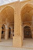 Nain old mosque architecture. NAIN, IRAN - MAY 6, 2015: Arcade in inner courtyard of the old Jame mosque in Iran Royalty Free Stock Image