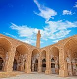 Nain old mosque architecture. NAIN, IRAN - MAY 6, 2015: Arcade in inner courtyard of the old Jame mosque one of the oldest mosque in Iran Royalty Free Stock Photos