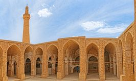 Nain old mosque architecture. NAIN, IRAN - MAY 6, 2015: Arcade in inner courtyard of the old Jame mosque one of the oldest mosque in Iran Royalty Free Stock Photo