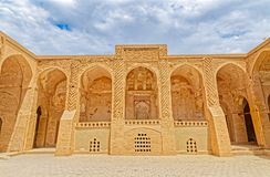 Nain old mosque courtyard. NAIN, IRAN - MAY 6, 2015: Arcade in inner courtyard of the old Jame mosque one of the oldest mosque in Iran Royalty Free Stock Image