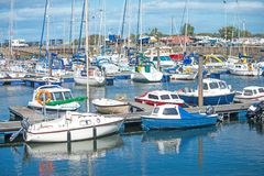 Nairn harbor with yachts and caravans. The seaside resort of Nairn on the Eastern coast of Scotland showing yachts and holiday caravans stock images