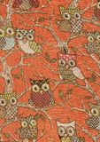 Naive owls on orange background. Royalty Free Stock Images