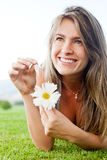 Naive woman with a flower Royalty Free Stock Images