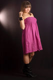 A naive young girl. In a pink dress Stock Photo
