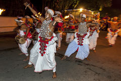 Naiyandi Dancers and drummers perform at the commencement of the Esala Perahera in Kandy, Sri Lanka. The Esala Perahera (great procession) is held to honour Stock Photo