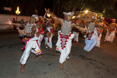 Naiyandi Dancers and drummers perform at the commencement of the Esala Perahera in Kandy, Sri Lanka. The Esala Perahera (great procession) is held to honour Stock Image