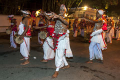 Naiyandi Dancers and drummers perform at the commencement of the Esala Perahera in Kandy, Sri Lanka. royalty free stock photography