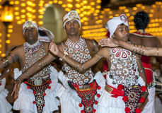 Naiyandi Dancers perform at the commencement of the Esala Perahera in Kandy, Sri Lanka. The Esala Perahera (great procession) is held to honour the Sacred Stock Images