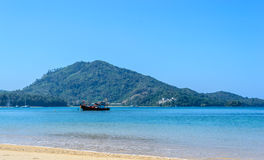 Naiyang beach with mountains and blue sky background Stock Photos