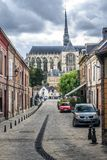 Cathedral of Amiens, France. Amiens with a street in the Saint Leu district, the little Venice of the North, with a view of the Cathedral Basilica of Our Lady stock image