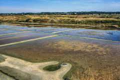 Salt pans, Guérande, Loire-Atlantique, France. Salt pans for the extraction of sea salt at the Atlantic Ocean. Sea water irrigates a complicated network of royalty free stock photography