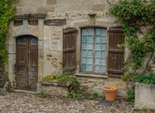 Stone facade with wooden door and window royalty free stock images