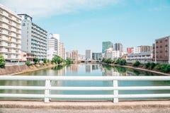 River and modern buildings in Fukuoka, Japan. Naka river and modern buildings in Fukuoka, Japan Royalty Free Stock Image