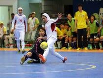 NAKAJIMA Shiori of Japan (L) and ETEDADI Fatemeh of Iran fight for the ball. Incheon - July 5:NAKAJIMA Shiori of Japan (L) and ETEDADI Fatemeh of Iran fight for Stock Image