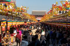 Nakamise Dori shopping street. JAPAN, TOKYO, NOV 18 2016, Nakamise Dori shopping street way to Asakusa Sensoji-ji Temple, Tokyo, Japan. People at Traditional Stock Images