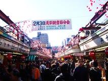 Nakamise Shopping Street in Tokyo, Japan. TOKYO, JAPAN - February 1: People floating to Asakusa Temple through Nakamise Street ,on February 1, 2009 in Tokyo Royalty Free Stock Image