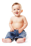 Naked baby-boy in jeans Royalty Free Stock Photos