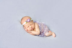 Naked baby girl sleeping on her side Royalty Free Stock Photo