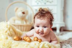 Naked baby lying on blanket Stock Photo