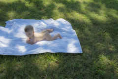 Naked Baby on Quilt Outdoors Stock Photography