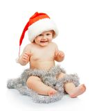 Naked baby in Santa Claus red Royalty Free Stock Photo