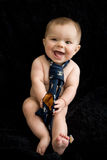 Naked Baby Boy in tie. A naked baby boy with a tie on a black background smiling and excited Royalty Free Stock Photography